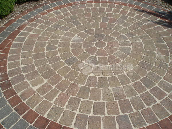 Decorative circle after pressure washing and resanding